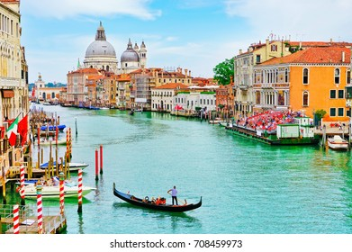 Venice, Italy - September 4, 2016 : View of the historical gondola race- Regata Storica with lots of Gondolas rowing on the Grand Canal in Venice on September 4, 2016.