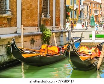 VENICE, ITALY - SEPTEMBER 6, 2013: Venetian gondolas are moored on the channel. Venice, Italy