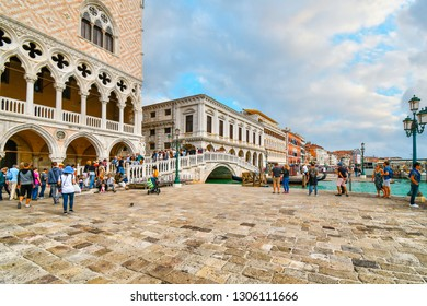 Venice, Italy - September 9 2018: Tourists cross the Riva degli Schiavoni bridge by the Doge's Palace, Palazzo Ducale and St. Mark's Square in Venice, Italy