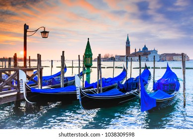 Venice, Italy. Sunrise with Gondolas on Grand Canal, Piazza San Marco, Adriatic Sea.