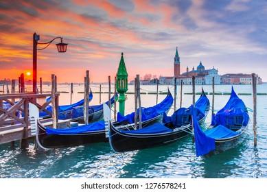 Venice, Italy. Sunrise with Gondolas on Grand Canal, Piazza San Marco, Adriatic Sea.
