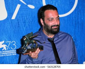 Venice, Italy.10 September, 2016.  Director Ala Eddine Slim poses with the Lion of the Future 'Luigi de Laurentiis' Venice award for the movie 'The Last of Us' during the  73rd Venice Film Festival .