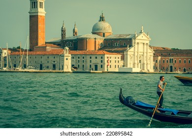 Venice, Italy,August 9, 2013:Traditional Gondola on Canal Grande with San Giorgio Maggiore church in the background at sunset, San Marco, Venice, Italy