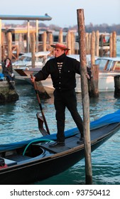 VENICE, ITALY-FEBRUARY 26:Unidentified gondolier sail on a Venetian canal during the Carnival of Venice on February 26, 2011. In 2012 the Carnival will be between 11- 21 February.