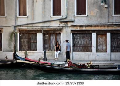 Venice, Italy-July 3, 2011: Girl and Gondolier, Venice.