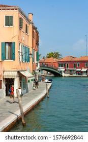 Venice, Italy-September 14, 2011: scenic canal promenade on Murano island, Murano, Venice, Italy