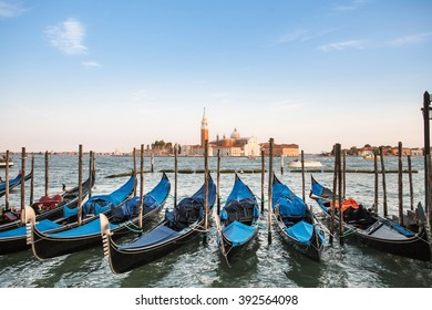Venice lagoon landscape with gondolas on the Grand Canal. Italian landscape with views of the lagoon in blue