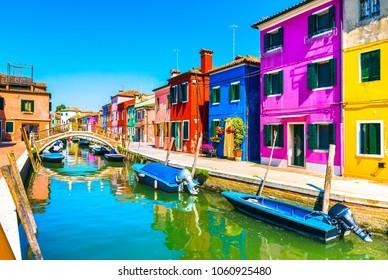 Venice landmark, Burano island canal, bridge, colorful houses and boats, Italy, Europe.