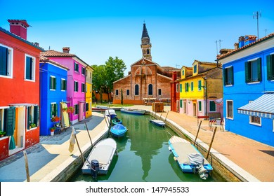 Venice landmark, Burano island canal, colorful houses church and boats, Italy. Long exposure photography