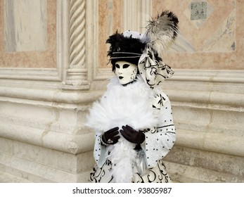 VENICE - MARCH 5: An unidentified person in a Venetian costume attends the Carnival of Venice, festival starting two weeks before Ash Wednesday and ends on Shrove Tuesday, on March 5, 2011 in Venice, Italy.