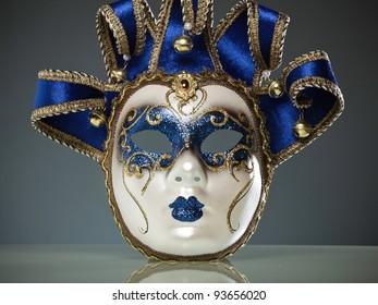 Venice mask against blue toned background