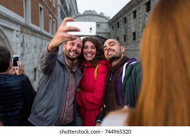 Venice - October 04: Unknown tourists make a selfie in front of the famous Ponte dei Sospiri bridge on October 04, 2017 in Venice