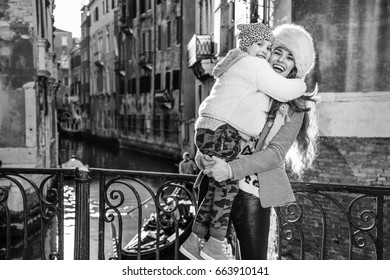 Venice. Off the Beaten Path. smiling trendy mother and daughter tourists in Venice, Italy in the winter hugging
