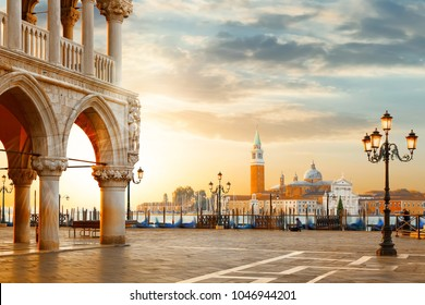 Venice postcard. World famous Venice landmarks. St. Mark's San Marco square with San Giorgio Maggiore church during amazing sunrise. Tourism and travel concept in Italy.
