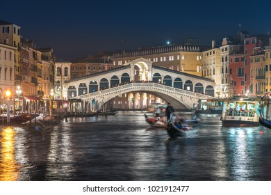Venice Rialto Bridge and Grand Canal at night, Gondolas in Grand Canal.