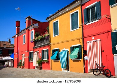 VENICE - SEPTEMBER 3: Small, brightly painted houses, popular with tourists on the island of the Burano on September 3, 2013 in Venice. Burano is situated 7 kilometers from Venice.