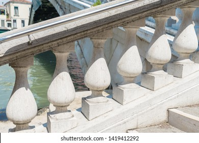 Venice. Оld stone balustrade of railing. Architecture detail Stone Balustrade Of Old Handrail Of Staircase. Banisters Balusters. Historic Bridge Staircase in Venice. Ancient Classic Landmark.