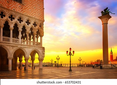 Venice sunrise, famous Doge palace, column with winged lion and San Marco square at sunrise in Venice, Italy, retro toned