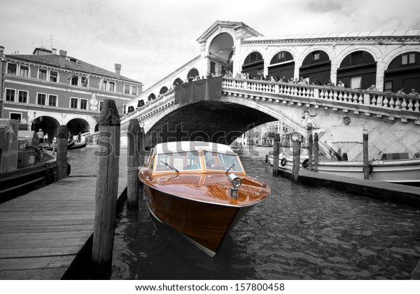 Venice taxi boat colorkey New York cab style with view of city in background, Italy, Europe