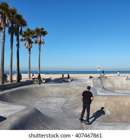VENICE, UNITED STATES - APRIL 6, 2014: People visit skate park at Venice Beach, California. Venice Beach is one of most popular beaches of LA County. 9.8 million people live in LA County.