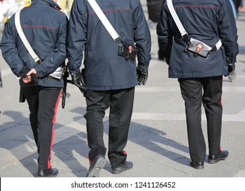 Venice, VE, Italy - February 5, 2018: three italian cops called Carabinieri in the Saint Mark Square during the Carnival Festival