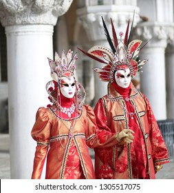 Venice, VE, Italy - February 5, 2018: man and woman with great masks at the Venice Carnival in Saint Mark Square