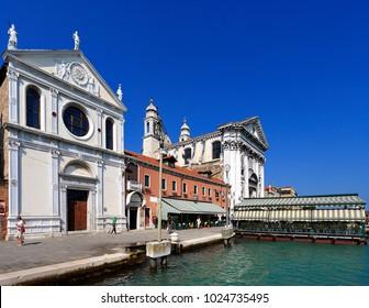 Venice, Veneto / Italy - 2012/07/05: Venice city center - Santa Maria della Visitazione church and St. Mary of the Rosary church - by the Fondamenta Zattere Ai Gesuati