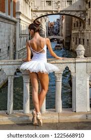 Venice, Veneto, Italy, 21.8.2018, pretty balletgirl on the Sospiri bridge in Venezia