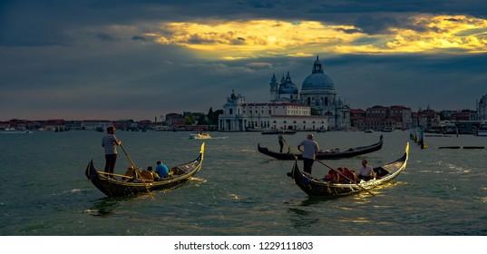 Venice, Veneto, Italy, 26.7.2018, before the storm gondolas near to cathedral Santa Maria della Salute in Venezia
