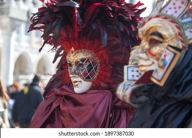 Venice, Veneto , Italy - Feb. 26, 2011: People in traditional costumes and masks outdoors during the famous Venice Carnival