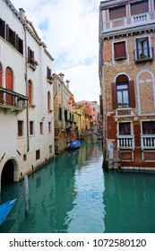 Venice, Veneto / Italy - March 2018: Colorful buildings line the waterway in Venice, Italy.