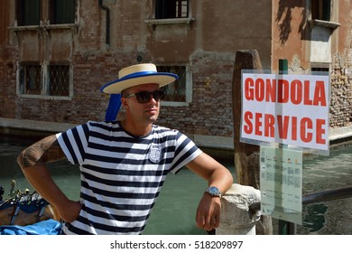 Venice, Veneto, Italy - September 8, 2016: Gondolier with the typical headgear on a canal of Venice in Italy.