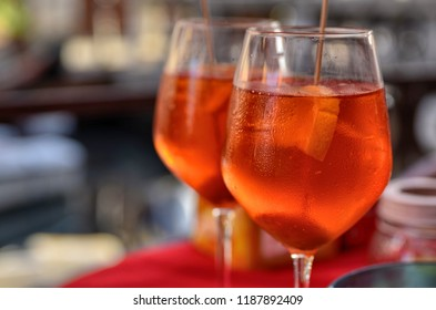 Venice, Veneto Region, Italy. August 2018. Savoring a spritz in Venice is a must if you visit the city. Towards late afternoon the bars are colored with full glasses of tasty and refreshing aperitifs.