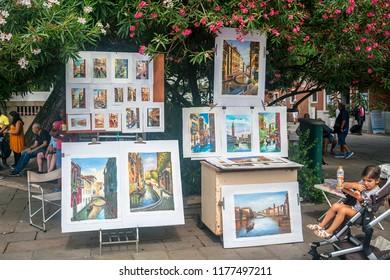 Venice (Venezia), Italy, August 14, 2018: paintings for sale on Venice street