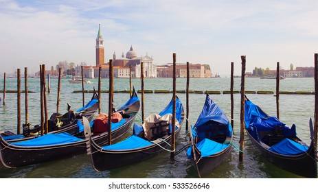 Venice view of church with gondolas.
