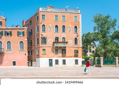 Venice. View of Venice Streets, canals, bridges, gondolas. Biennale. Colorful Old Authentic Buildings in Venice: doors, windows. Architecture of Ancient Italian city. Travel Tourism Concept.