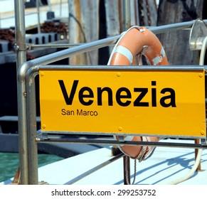 venice written in the ferry boat stopper in Saint Mark square
