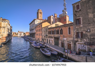 Venice/Italy - 15th July 2014: Evening in Venice, people chilling in the shadow