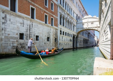 Venice,Italy -August 17,2014:A gondola passes under the bridge of sighs in Venice during a sunny day