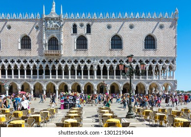 Venice,Italy -August 17,2014:Tourists visiting the famous Piazza San Marco in Venice during a sunny day