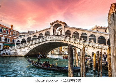 Venice,Italy-04.02.2018: Panoramic view of famous Canal Grande and Rialto Bridge.The Grand Canal and Rialto bridge at sunset, Venice, Italy