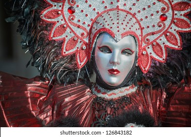 VENICE,ITALY-FEB.17 : Unrecognizable person wearing carnival costume and posing in Saint Mark square on February 17, 2012 in Venice, Italy. In 2012 the Carnival was held between 11-21 February.