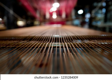 VENICE-ITALY-OCTOBER 18, 2018: traditional Bevilacqua weavers workshop, handycraft women work on more than 200 years old wooden loom weavings, producing luxury textiles, in Venice.