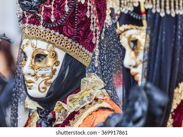 VENICE-MAR 02:  Portrait of a person with a Venetian mask in San Marco Square  on March 02,2014 in Venice, Italy, during the Carnival days.
