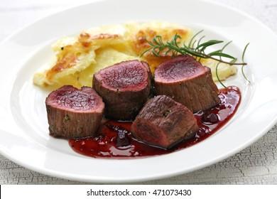 venison steak with creamy baked potato