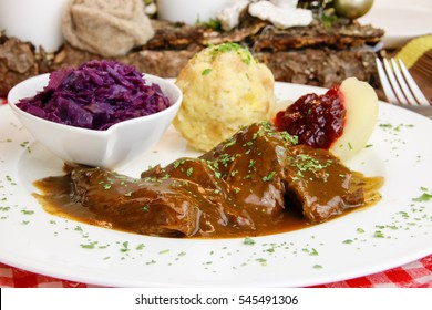 venison steak with red cabbage and bread dumpling