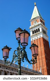 Venitian Lamp with famous Campanile at St Mark's Square in the background. Venice, Italy
