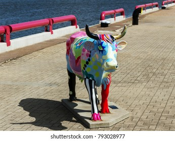 VENSPILS,  LATVIA - 31 July: City is situated on the Venta River and the Baltic Sea, and has an ice-free port. A cow ckulpture on the coastline of river on 31 July 2016, Venspils, Latvia.