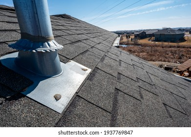 Vent on a shingle roof with silicon caulking and flashing for a water tight seal