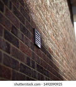 A vent in the wall with a slight shadow, Brick wall vent.